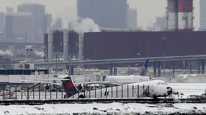 Plane skids off LaGuardia runway, crashes into fence by bay