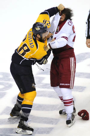 Nashville Predators center Paul Gaustad (28) and Phoenix Coyotes center Kyle Chipchura (24) fight in the first period of Game 4 in an NHL hockey Stanley Cup Western Conference semifinal playoff series, Friday, May 4, 2012, in Nashville, Tenn. (AP Photo/Mike Strasinger)