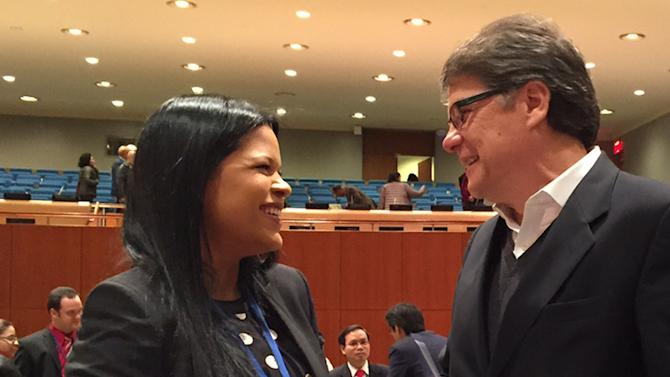 Maria Gabriela Chavez, the daughter of late Venezuelan leader Hugo Chavez, speaks with Xavier Lasso, Ecuador's ambassador to the United Nations, Wednesday, April 1, 2015 at United Nations headquarters. Chavez is Venezuela's deputy permanent representative to the United Nations. (AP Photo/Cara Anna)