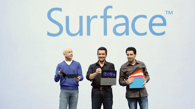 COMMERCIAL IMAGE - In this photograph taken by AP Images for Microsoft, Steven Sinofsky, President, Windows and Windows Live Division; Mike Angiulo, Corporate Vice President Windows Planning, Hardwire and PC Ecosystem; and Panos Panay, General Manager Microsoft Surface; reveal Surface, a new family of PCs, for Windows, Monday, June 18, 2012, in Los Angeles. (Rene Macura/AP Images for Mircrosoft)