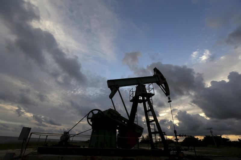 Oil hits two-week highs on Mideast tensions, U.S. gasoline rally