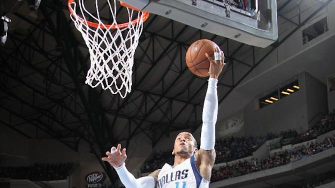 Ellis leads Mavericks to 114-87 rout of Wizards