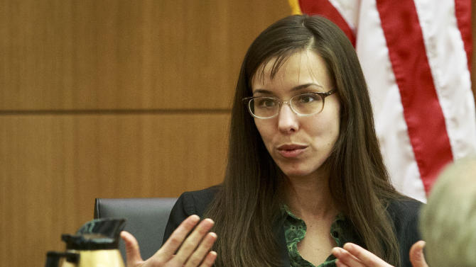 Defendant Jodi Arias describes her relationship with Travis Alexander and  answers questions from her attorney Kirk Nurmi as she testifies in her murder trial in Judge Sherry Stephens' Superior Court, on Wednesday, Feb. 6, 2013.  Arias, 32, is accused of stabbing and slashing Alexander, 27 times, slitting his throat and shooting him in the head in his suburban Phoenix home in June 2008. She initially denied any involvement, then later blamed it on masked intruders before eventually settling on self-defense.  (AP Photo/The Arizona Republic, Charlie Leight)