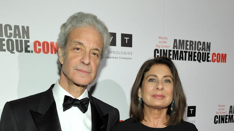 Rick Nicita, left, and Paula Wagner attend the presentation of the 27th Annual American Cinematheque Award to Jerry Bruckheimer on Thursday, Dec. 12, 2013, in Beverly Hills, Calif. (Photo by John Shearer/Invision for American Cinematheque/AP Images)