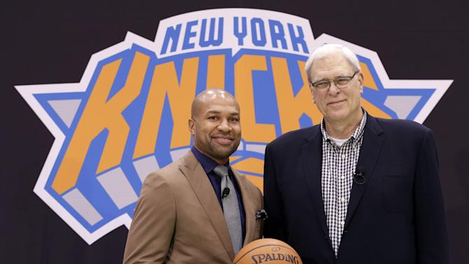 New York Knicks president Phil Jackson, right, poses with Derek Fisher during a news conference in Tarrytown, N.Y., Tuesday, June 10, 2014. The Knicks hired Fisher as their new coach on Tuesday, with Jackson turning to one of his trustiest former players