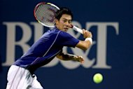 Kei Nishikori of Japan returns a shot to Ricardas Berankis of Lithuania during the BB&T Atlanta Open in Atlanta. Nishikori and Go Soeda are ATP Tour opponents one week, and Olympic teammates the next