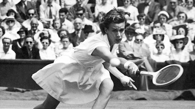 FILE - In this June 30, 1951, file photo, Doris Hart strives to reach a return from her opponent Jean Quertier in a singles tennis match at Wimbledon, London, England. Hart, who won each Grand Slam tournament at least once, and once won three Wimbledon titles in a single day, died Friday, May 29, 2015, at her Miami area home, the International Tennis Hall of Fame confirmed to The Associated Press, citing close personal friends of Hart's. She was 89. (AP Photo/Leslie Priest, File)