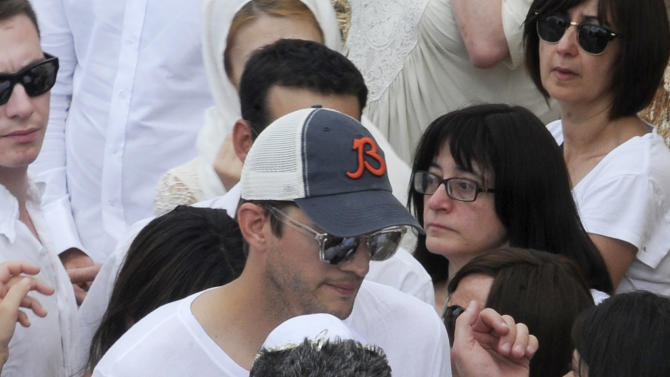 Hollywood actor Ashton Kutcher attends funeral of Rabbi Philip Berg in Safed, Israel, Wednesday, Sept. 18, 2013. Berg was Kutcher's Kaballah teacher and founded the Kabbalah Centre in Los Angeles more than 40 years ago. Though Kabbalah is rooted in Judaism, its message has in recent years become popular to people of all beliefs. (AP Photo/Jininpix) ISRAEL OUT