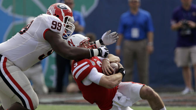 Georgia defensive lineman Kwame Geathers (99) stops Nebraska quarterback Taylor Martinez (3) for no gain during the first half of the Capital One Bowl NCAA football game, Tuesday, Jan. 1, 2013, in Orlando, Fla. (AP Photo/John Raoux)