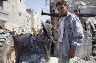 Rebels of the Free Syrian Army arrive at an area said to have been hit by government shelling in the Sheikh Najar area of the restive city of Aleppo on August 6. President Bashar al-Assad vowed on Tuesday to crush the 17-month rebellion against his regime and to cleanse Syria of &quot;terrorists,&quot; as his troops engaged rebels in Aleppo