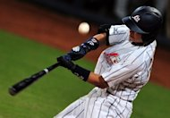 Japan's Takahiro Arai fouls off a pitch during a game in 2008. Two-time champions Japan said Tuesday they would defend their World Baseball Classic (WBC) title next year, reversing an earlier decision to boycott the premier international event over a revenue-sharing row
