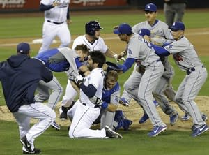 San Diego Padres' Carlos Quentin and teammates battle the Los Angeles Dodgers after Quentin was hit by a pitch thrown by Dodgers pitcher Zack Greinke in the sixth inning of baseball game in San Diego, Thursday, April 11, 2013. (AP Photo/Lenny Ignelzi)