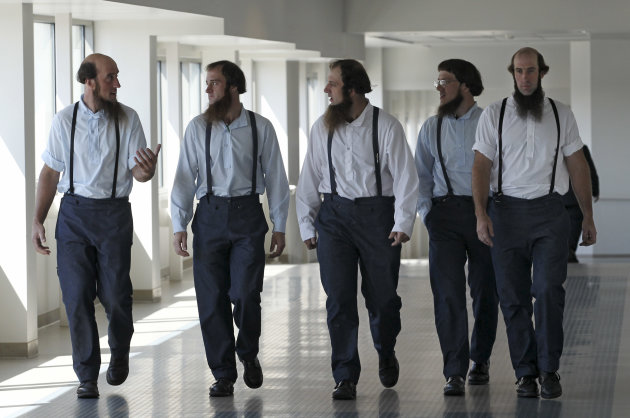 Members of the Amish leave the U.S. Federal Courthouse Tuesday, Aug. 28, 2012, in Cleveland. A breakaway religious group spent months planning hair-cutting attacks against followers of their Amish fai