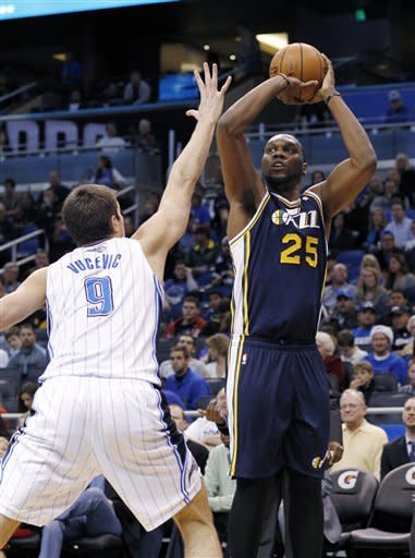 Jazz survive late rally to beat Magic 97-93