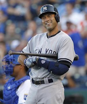 New York Yankees' Derek Jeter looks for a sign from the third base coach before his first at-bat in his final regular-season baseball game against the Kansas City Royals at Kauffman Stadium in Kansas City, Mo., Monday, Aug. 25, 2014. (AP Photo/Colin E. Braley)