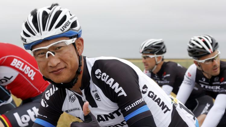 Giant-Shimano team rider Cheng Ji of China reacts as he cycles among the pack during the 234.5 km seventh stage of the Tour de France cycling race from Epernay to Nancy