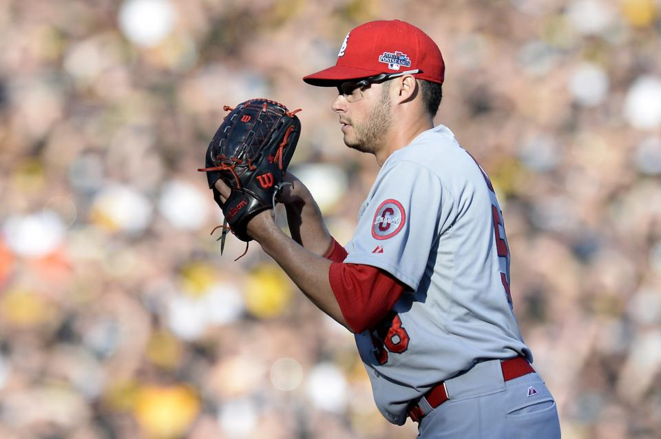 St. Louis Cardinals relief pitcher Joe Kelly looks in to throw against the Pittsburgh Pirates in the first inning of Game 3 of a National League division baseball series on Sunday, Oct. 6, 2013, in Pittsburgh .(AP Photo/Don Wright)