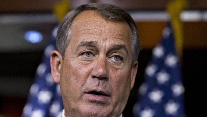 "FILE – In this March 13, 2013 file photo the House Speaker, Republican John Boehner of Ohio, talks to reporters on Capitol Hill in Washington after a closed-door meeting with President Barack Obama to discuss the budget.  On Sunday, March 17, 2013, Boehner said he ""absolutely"" trusts Obama, not that they don't have their differences. He told ABC's ""This Week"" that the two have a good relationship and that they're ""open with each other ... honest with each other."" But they're trying to bridge some big differences, he said. One issue on which they agree: The U.S. doesn't have an immediate crisis in terms of debt. (AP Photo/J. Scott Applewhite, File)"