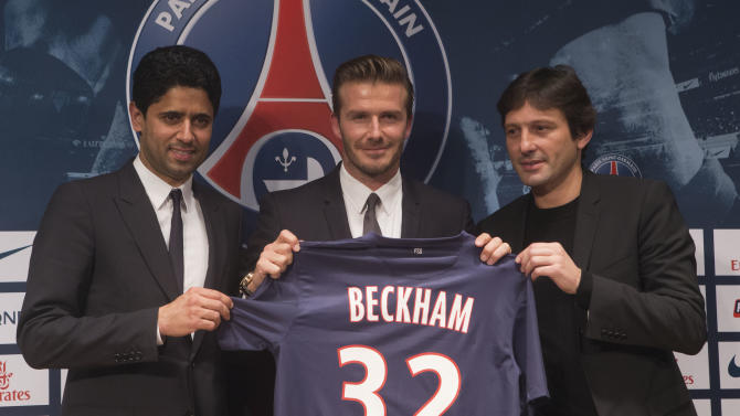 Paris Saint Germain's President Nasser Al-Khelaifi, left, British soccer player David Backham, and Sports Director Leonardo, right, pose with Backham's jersey during a press conference, in at the Parc des Princes stadium in Paris, Thursday, Jan. 31, 2013. David Beckham will join Paris Saint-Germain on Thursday, opting for a move to France after mulling over lucrative offers from around the world since leaving the Los Angeles Galaxy.(AP Photo/Michel Euler)