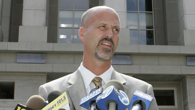 FILE - In this Wednesday, Aug. 29, 2007, file photo, Michael Drewniak, spokesman for the U.S. Attorney's office, speaks to reporters outside the U.S. District courthouse in Newark, N.J. Drewniak, a longtime aide to Republican New Jersey Gov. Chris Christie, has given testimony to a federal grand jury in an investigation of traffic jams created near the George Washington Bridge in a political payback scandal. Attorney Anthony Iacullo tells ABC News his client Drewniak is not a target of the investigation but was in federal court to answer questions Friday, April 4, 2014. (AP Photo/Mike Derer, File)