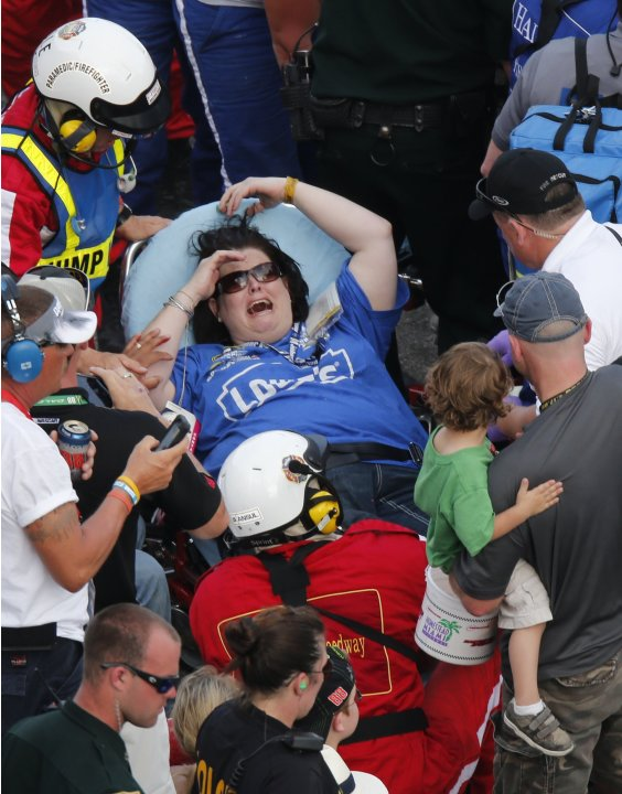 Rescue workers attend to the injured in the stands following a last-lap incident during the NASCAR Nationwide Series DRIVE4COPD 300 race at the Daytona International Speedway in Daytona Beach