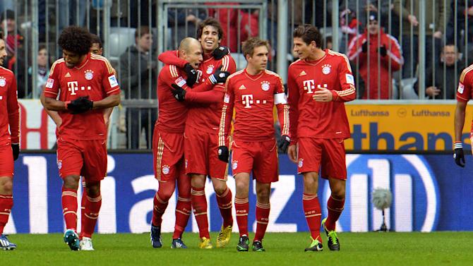 Bayern's players celebrate after scoring   during the German first division Bundesliga soccer match between FC Bayern Munich and SV Werder Bremen  in Munich, Germany, Saturday, Feb. 23, 2013. (AP Photo/Kerstin Joensson)