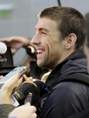 U.S. Olympic swim team member Michael Phelps speaks with the media after practice at the University of Tennessee's Allan Jones Aquatic Center, Thursday, July, 12, 2012, in Knoxville, Tenn. (AP Photo/Knoxville News Sentinel, Michael Patrick)