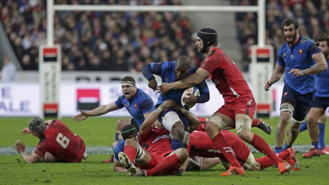 Wales' Charteris tackles France's Ben Arous during their Six Nations rugby union match at the Stade de France stadium in Saint-Denis, near Paris