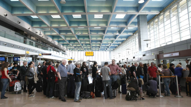 Passengers wait for a flight at Marseille-Provence Airport, in Marignane, southern France, Tuesday, June 11, 2013, as France's main airports have cut their flight timetables in half to cope with a three-day strike by air traffic controllers. The Civil Aviation Authority said that some 1,800 flights were cut Tuesday to protest against a plan to centralize control of Europe's air space. (AP Photo/Claude Paris)