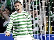 Celtic's Gary Hooper celebrates scoring during an August 2012 match. Reigning Scottish Premier League champions Celtic returned to winning ways with a 2-0 victory at home to bottom of the table Dundee