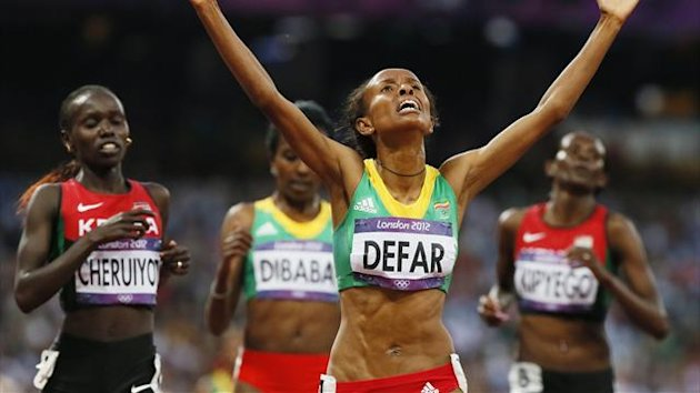Ethiopia's Meseret Defar reacts after she won the women's 5000m final during the London 2012 Olympic Games at the Olympic Stadium August 10, 2012.