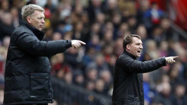 Liverpool's manager Rodgers and his Manchester United counterpart Moyes gesture during their English Premier League soccer match in Manchester