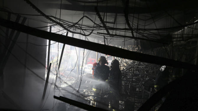 Fire spreads to hotel in China, killing 13 people