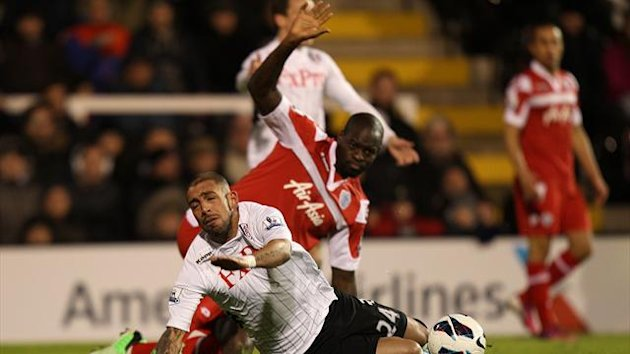 Fulham's Ashkan Dejagah (left) is fouled by Queens Park Rangers' Christopher Samba (PA Photos)