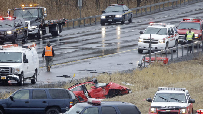 Law enforcement personnel work at the scene of a bus and motor vehicle crash on the Adirondack Northway on Tuesday, March 12, 2013, in Clifton Park, N.Y.  State transportation officials say the accident happened just before noon Tuesday. Police had no other information about the accident or any injuries. (AP Photo/Mike Groll)