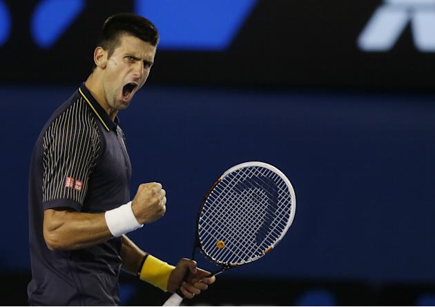 Serbia's Novak Djokovic reacts after winning the second set during the men's final against Britain's Andy Murray at the Australian Open tennis championship in Melbourne, Australia, Sunday, Jan. 27, 20