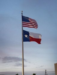 File picture shows an American flag and a Texas state flag. A Texas judge has sentenced a mother who superglued her toddler's hands to a wall to 99 years in prison, local media reported