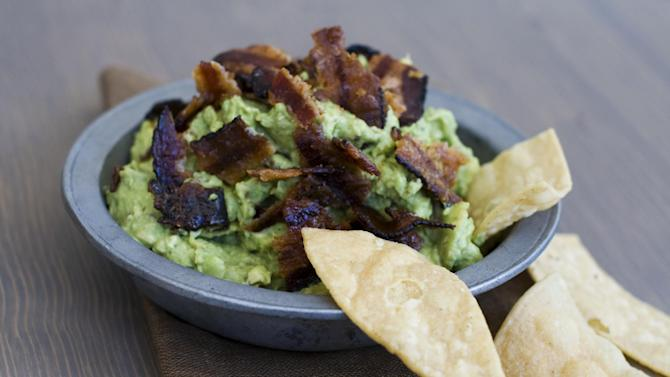 In this image taken on January 7, 2013, sweet heat bacon guacamole is shown served in a bowl in Concord, N.H. (AP Photo/Matthew Mead)