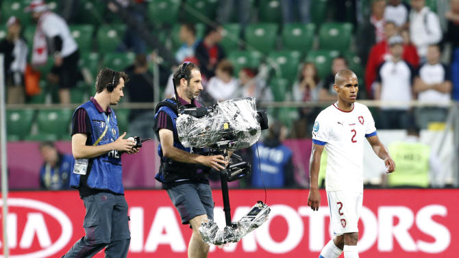 In this picture made available June 10, 2012 Czech Republic's Theodor Gebre Selassie walks from the pitch after the Euro 2012 soccer championship Group A match between Russia and Czech Republic in Wroclaw, Poland, Friday, June 8, 2012. UEFA said it is investigating reports by anti-racism experts of abuse directed at the Czech players during Russia's 4-1 victory. (AP Photo/Jon Super)