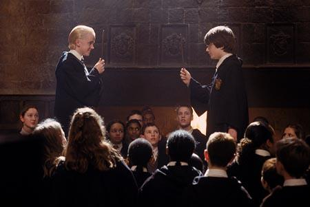 Draco Malfoy ( Tom Felton ) and Harry Potter ( Daniel Radcliffe ) in Harry Potter and The Chamber of Secrets