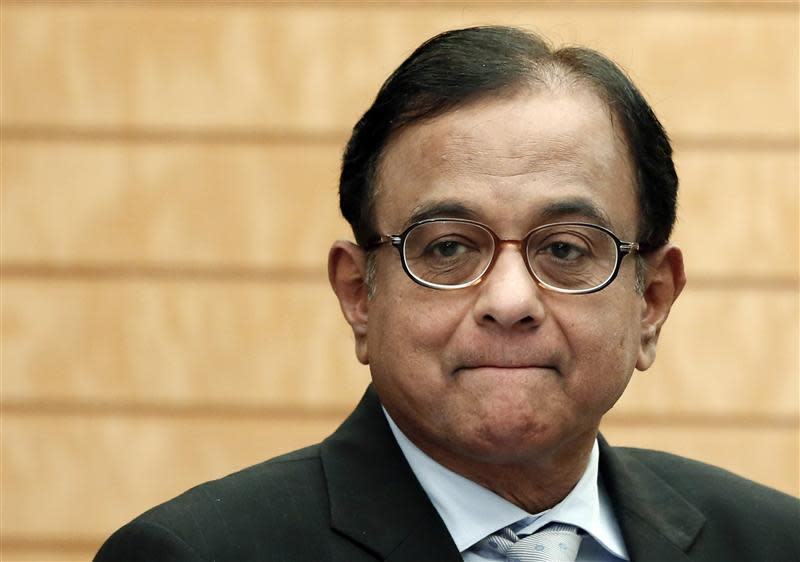 File photo of India's Finance Minister Palaniappan Chidambaram waiting for the arrival of Japan's Prime Minister Shinzo Abe before their meeting in Tokyo