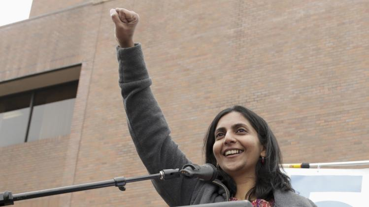 Seattle City Council member Kshama Sawant addresses rally in support of a $15 minimum wage at Seattle Central Community College