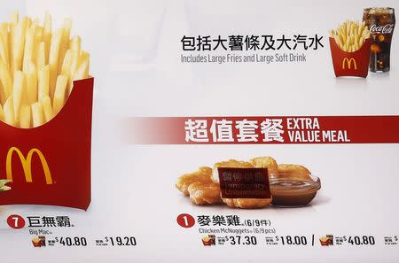 "A ""Temporary Unavailable"" sticker is placed on a picture of chicken nuggets on the menu at a McDonald's restaurant in Hong Kong"