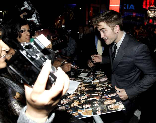 "Robert Pattinson arrives to the world premiere of ""The Twilight Saga: Breaking Dawn - Part 1"" on Monday, Nov. 14, 2011, in Los Angeles. (AP Photo/Matt Sayles)"