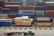 A truck drives past Maersk and COSCO containers at the deep-sea port of Shanghai in 2011. Chinese shipping giant COSCO is interested in investing in Croatia's main Adriatic port of Rijeka, a top company official said on Monday after meeting Prime Minister Zoran Milanovic
