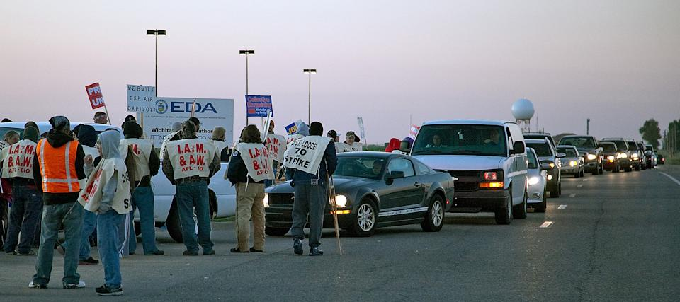 Machinist Union members picket Monday morning, Oct. 8, 2012, on Tyler road outside the entrance to the Bombardier Learjet factory in west Wichita, Kan. In a vote Saturday, nearly 80 percent of Bombardier's Machinist union members voted to strike. (AP Photo/The Wichita Eagle, Mike Hutmacher)