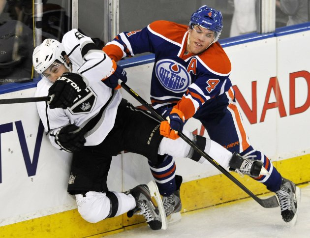Oilers' Hall hits Kings' Doughty during their NHL hockey game in Edmonton