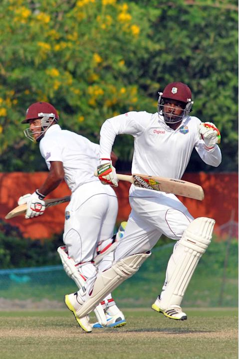 West Indies player Chris Gayle fetches a run during Day 3 of practice match between West Indies and Uttar Pradesh Cricket Association XI at the Jadavpur University Ground in Kolkata on Nov.2, 2013. (P