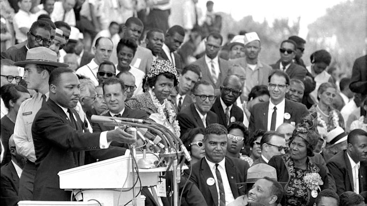 "FILE - The Rev. Dr. Martin Luther King Jr., head of the Southern Christian Leadership Conference, speaks to thousands during his ""I Have a Dream"" speech in front of the Lincoln Memorial for the March on Washington for Jobs and Freedom in Washington on Aug. 28, 1963. Actor-singer Sammy Davis Jr. is at bottom right. (AP Photo/File)"