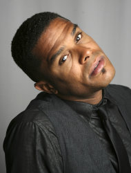 "FILE - In this Sept. 18, 2008 file photo, singer Maxwell poses for a portrait in New York. The soul crooner says his new album ""blackSUMMERS'night,"" due out in 2012, will be a little more upbeat compared to his previous efforts. (AP Photo/Seth Wenig, File)"
